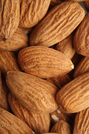 Beautiful : Almonds on white background - close-up
