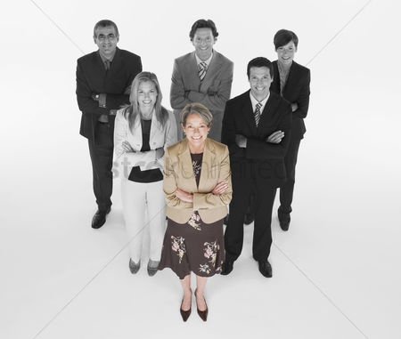 40 44 years : Ambitious businesswoman with team of professionals against white background