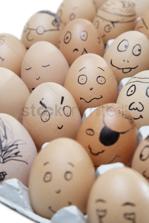 Egg tray : Anthropomorphic brown eggs arranged in carton against white background