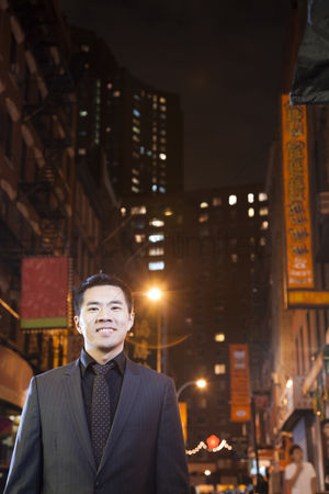 Proud : Asian man in chinatown at night