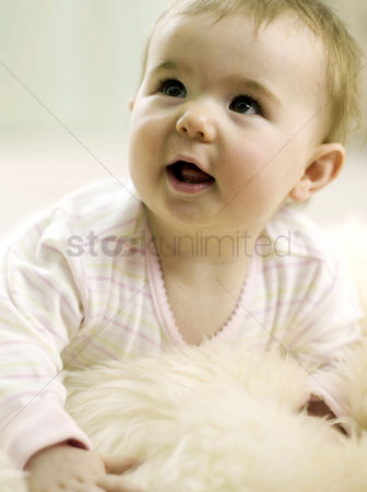 Adorable : Baby girl looking up while lying forward