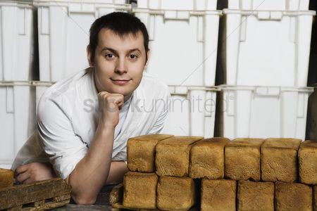 Posed : Baker with loaves of fresh bread