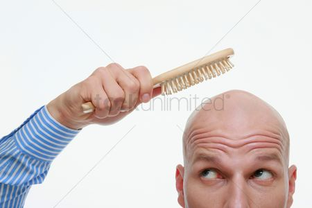 Bald : Bald man combing his head