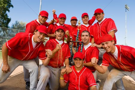 Spirit : Baseball team-mates holding trophy on field