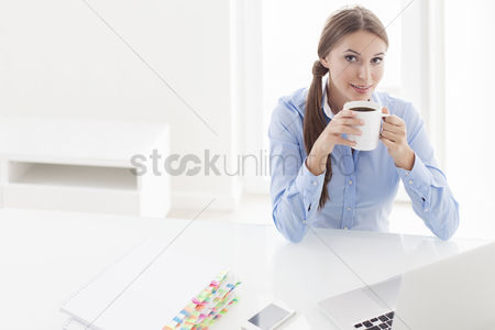 Beautiful : Beautiful woman drinking coffee at her desk