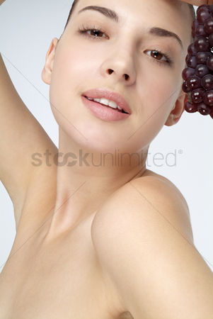 Grapes : Beautiful woman holding grapes