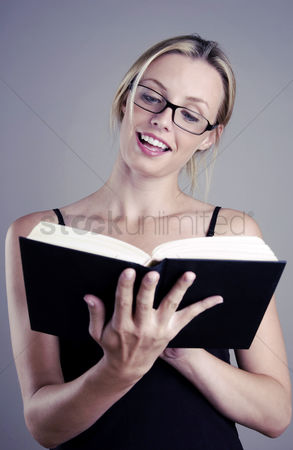 Bespectacled : Bespectacled woman reading book