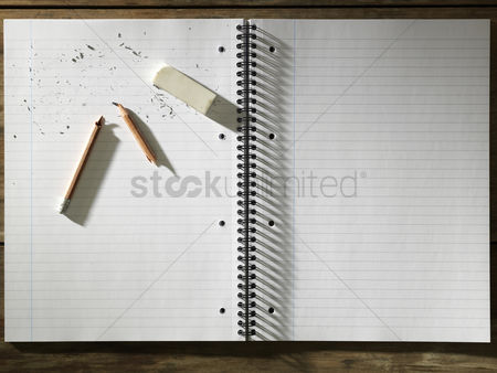 Notepad : Blank pad of paper eraser and broken pencil