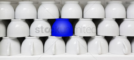 Collection : Blue cup amid white coffee cups