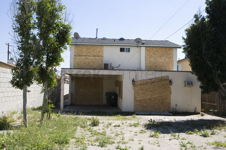 Loss : Boarded up house