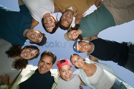 Friends : Boy  13-15  with friends and family in huddle view from below