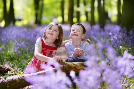 Children : Boy and girl in field of flowers