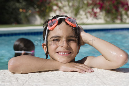 Young boy : Boy at edge of swimming pool