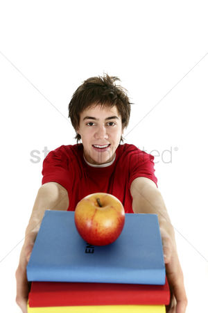 Workbook : Boy carrying a stack of books with a red apple on top
