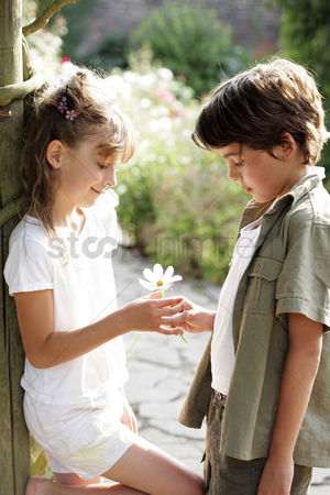 First : Boy giving flower to girl