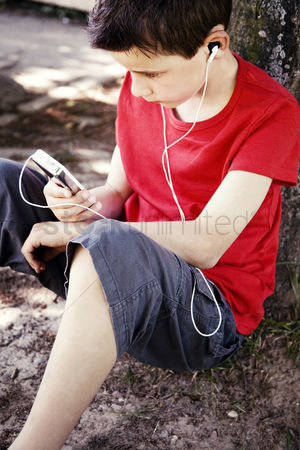 High school : Boy listening to music on a portable mp3 player