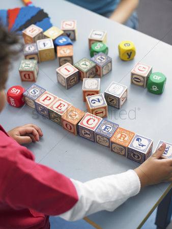 Children playing : Boy playing with alphabet blocks