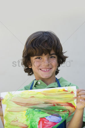 Schoolkids : Boy showing off painting