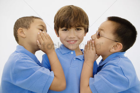 School children : Boys whispering