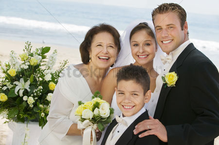 Pre teen : Bride and groom with mother and brother outdoors  portrait