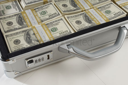 Us : Briefcase full of money