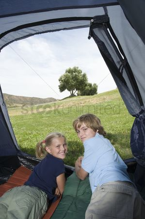 Pitch : Brother and sister lie in a tent looking back over their shoulders