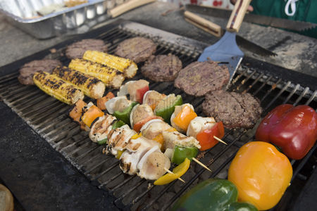 High angle view : Burgers and kebabs on barbecue grill