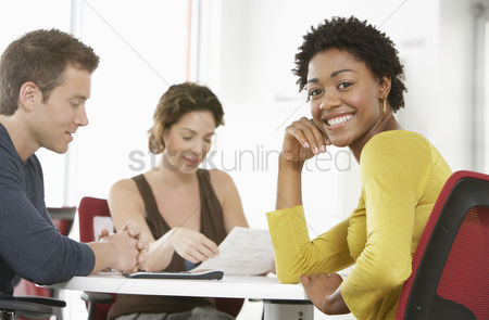 Young woman : Business colleagues in office meeting portrait