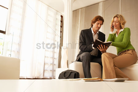 Office worker : Business couple talking in living room low angle view