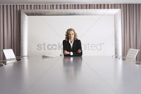 Satisfaction : Business executive sitting in boardroom