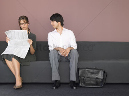 Interior background : Business man and woman on sofa
