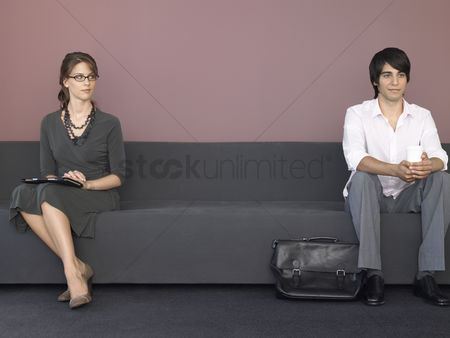 Interior background : Business man and woman sitting on sofa