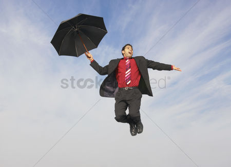 1879719 Man Floating Business Flying With Umbrella Mid Air Outdoors