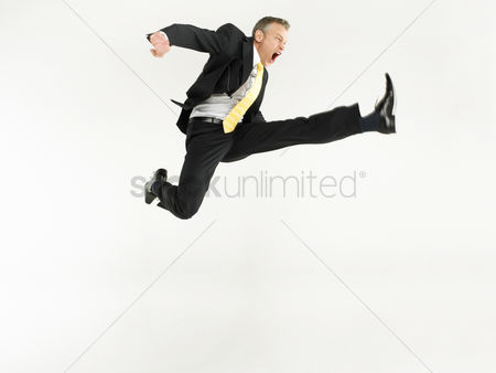 Rage : Business man jumping full length