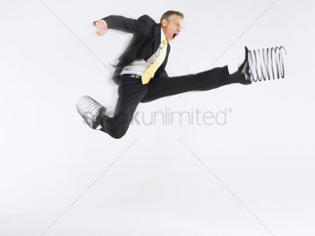 Rage : Business man jumping with springs on feet