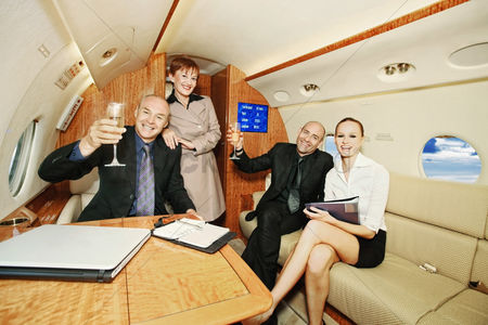 Refreshment : Business people in a private jet