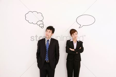 Cardboard cutout : Business people with thought and speech bubble above their heads