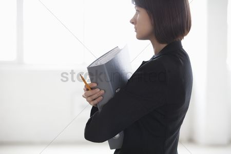 Jacket : Business woman on holding file in warehouse interior