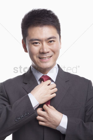 Proud : Businessman adjusting his tie