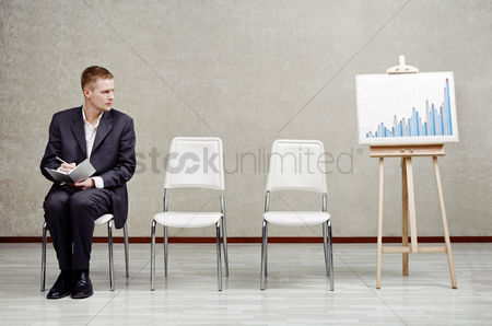 Thought : Businessman analyzing a chart
