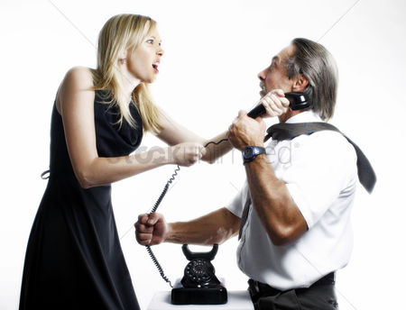 Rage : Businessman and businesswoman fighting over a phone