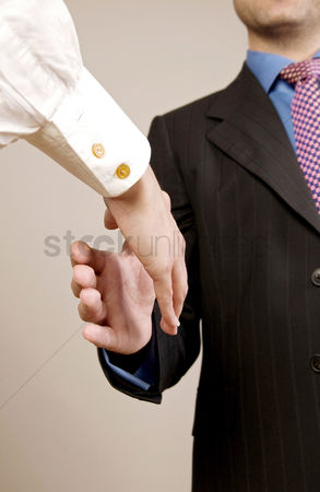 Employment issue : Businessman and businesswoman shaking hands