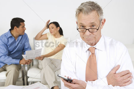 Senior women : Businessman assisting couple