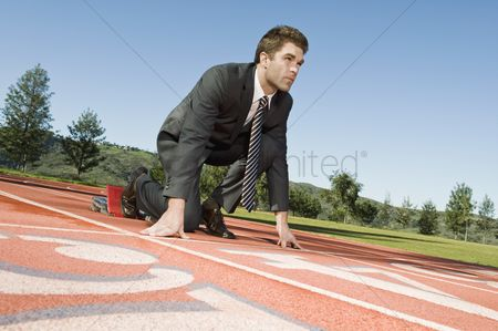 Determined : Businessman at starting blocks