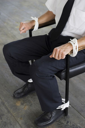 Rope : Businessman being tied to a chair