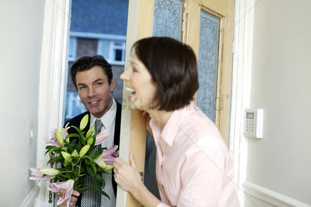 Lover : Businessman bringing home a bouquet of flowers for his wife