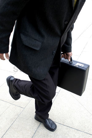 Man suit fashion : Businessman carrying a briefcase