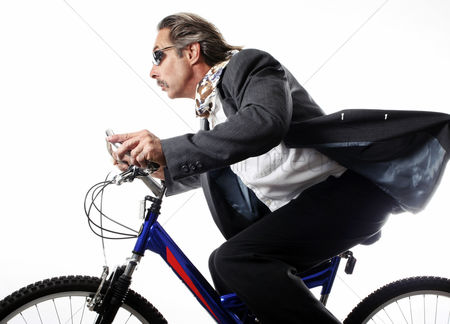 Strong : Businessman cycling