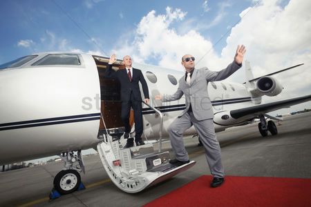 Business suit : Businessman descending from private jet with his bodyguard