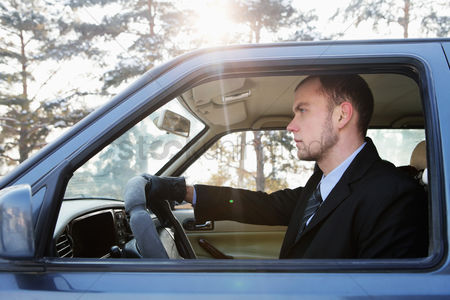 Cold temperature : Businessman driving on winter day